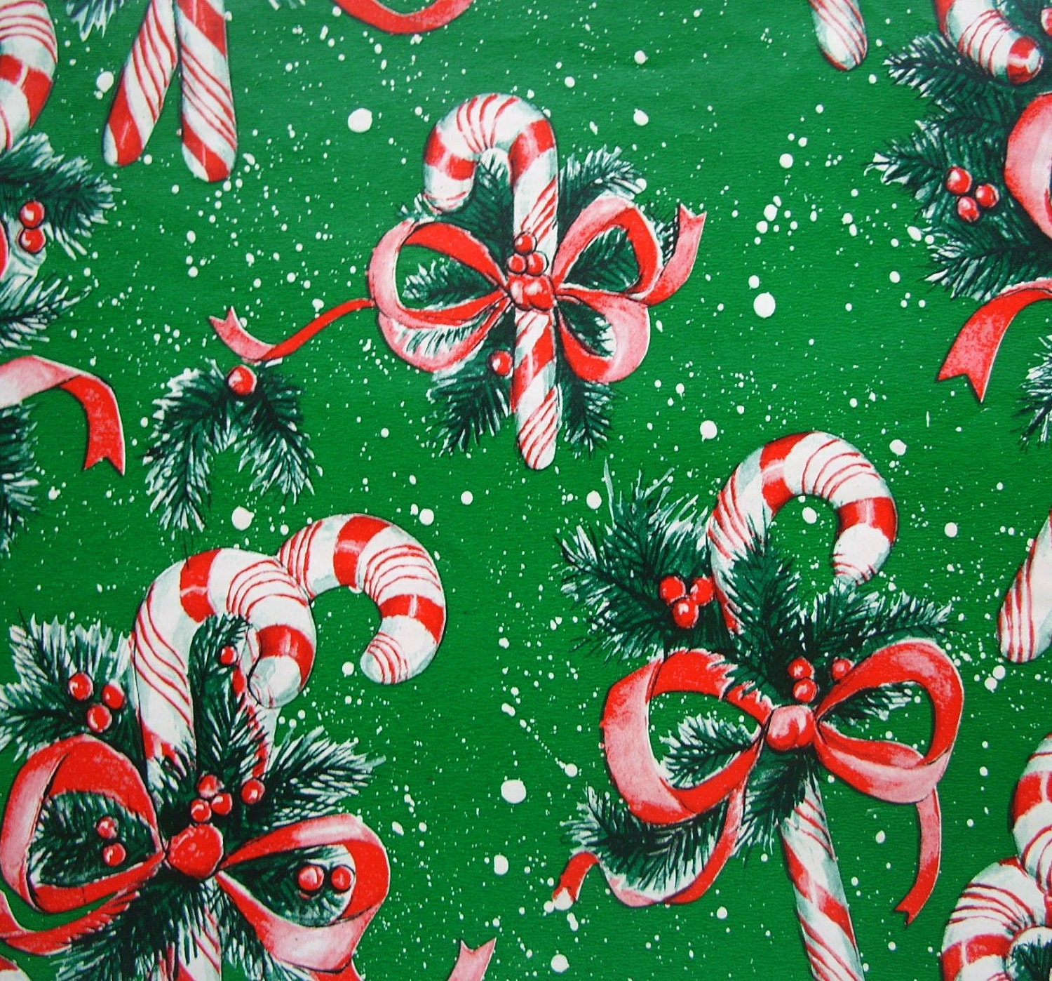 Vintage candy canes on green christmas wrapping paper full