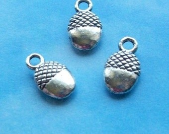 100 tiny acorn charms, silver tone, 12mm