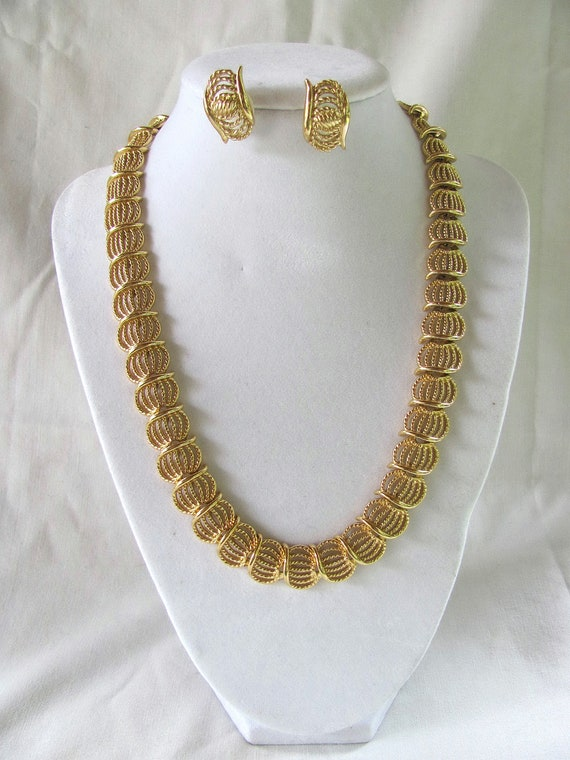 A lovely gold tone necklace and earrings for that special occasion