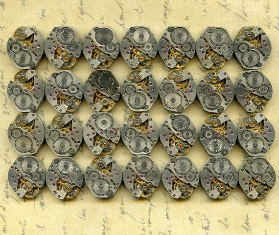 28 IDENTICAL tiny OVAL vintage watch movements...to use in your assemblage  Steampunk or Geek Jewelry 28-2