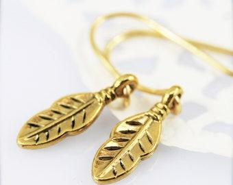 Teeny feather earrings