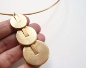 Choker. Art Deco statement necklace. Large vintage cascading deco brass coins on vintage wire choker.