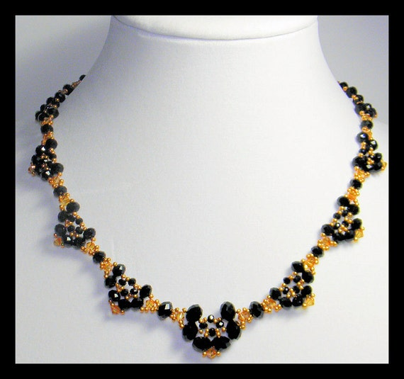 SALE -Nights in Black and Gold -Necklace with Swarovski Crystal,rondells,seed beads and 24Kt vermeil Gold