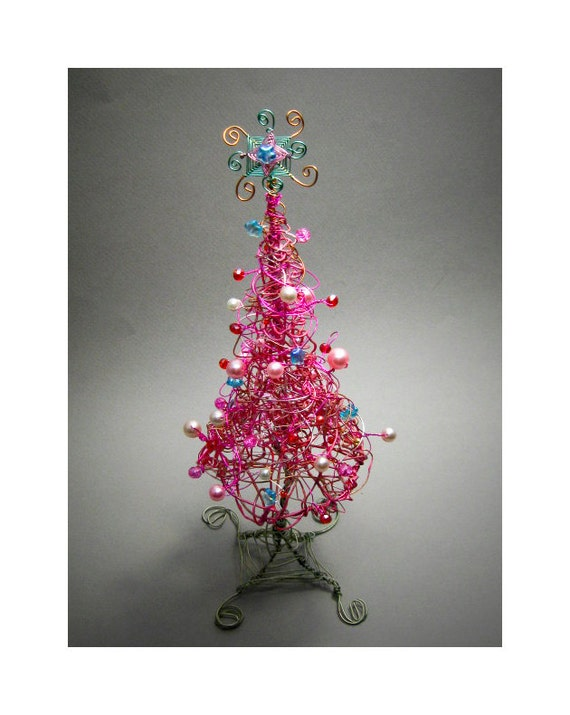 Hot pink christmas tree with handmade blue wire star