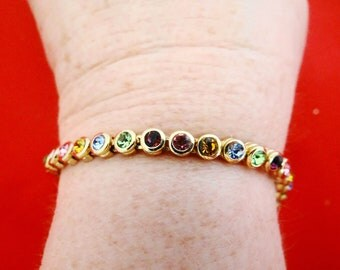 "Vintage multi-color rhinestone 7.25"" gold tone bracelet with sparkly stones in great condition"