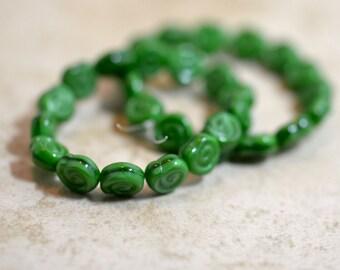Apple green Czech glass snail shell beads (15)  Item 1260