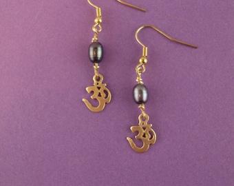 Om earrings with black pearl