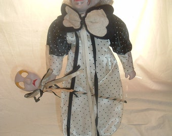 vintage musical clown with stand play send in the clowns
