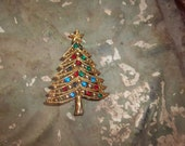 Vintage Christmas Tree Brooch adorned with  Stones in hues of Red Blue Green   Sale sale sale
