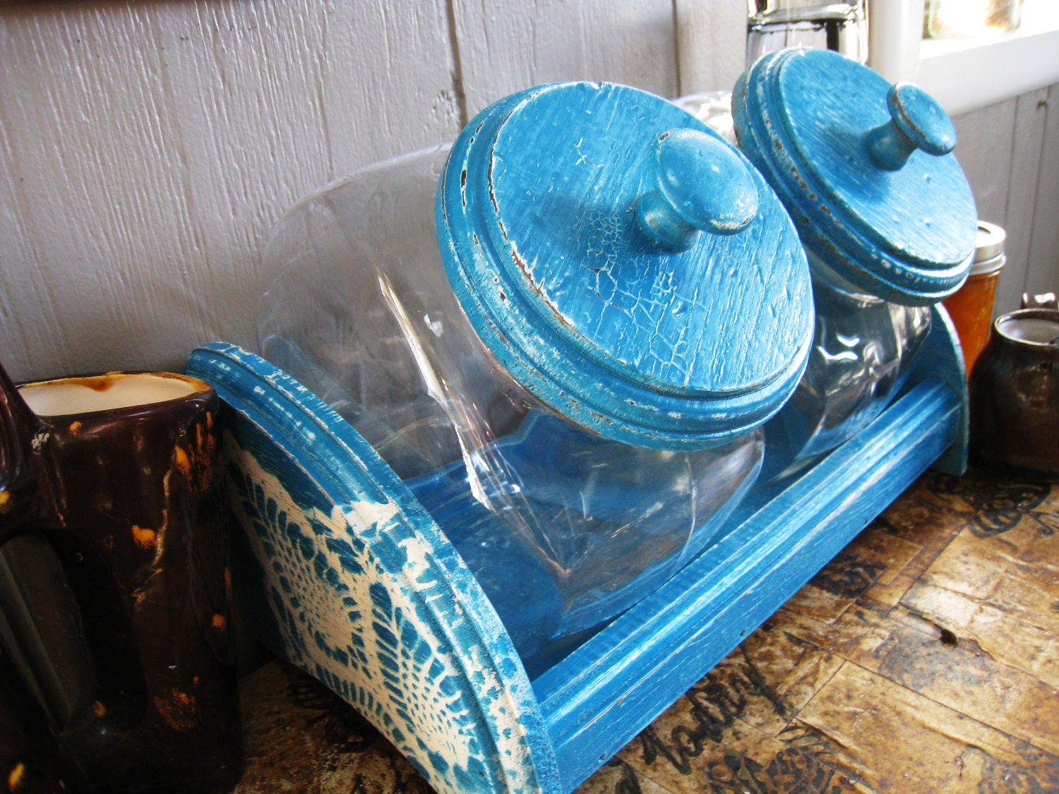 blue kitchen canister sets glass kitchen canister set with blue distressed lace detail 16457