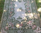 Green cream and pink rug