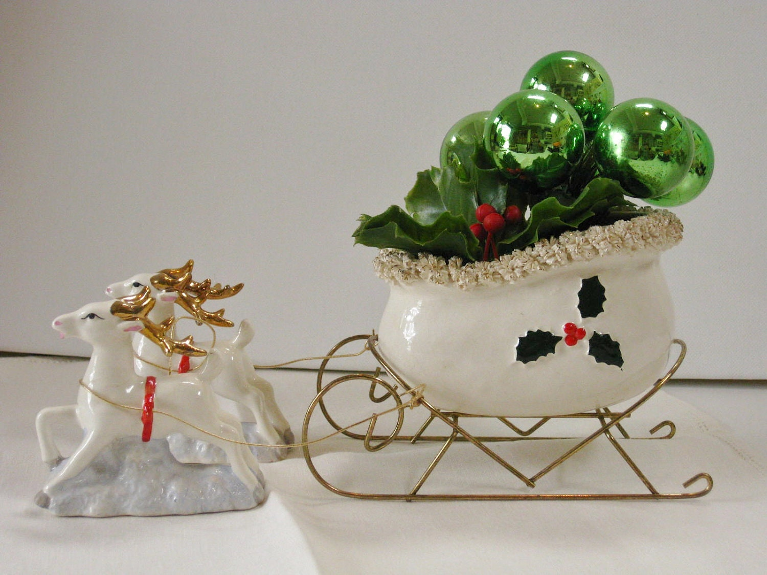 Vintage White Ceramic Sleigh And Reindeer Filled Plastic Holly