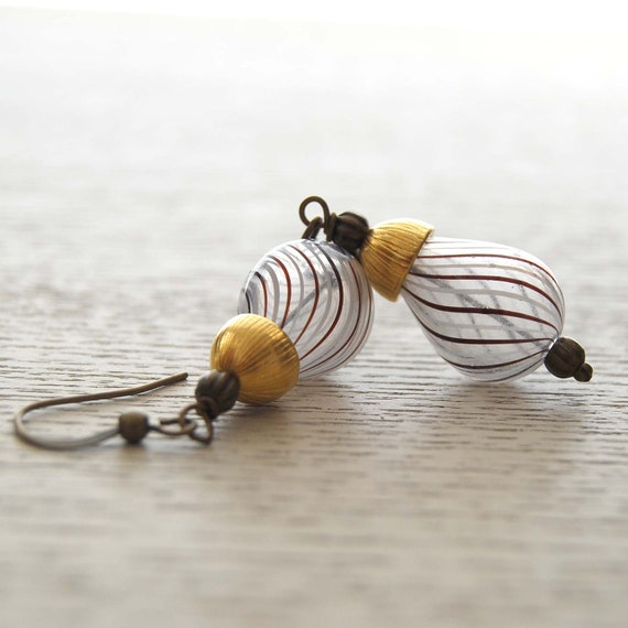 Golden Twirl Hollow Glass Earrings
