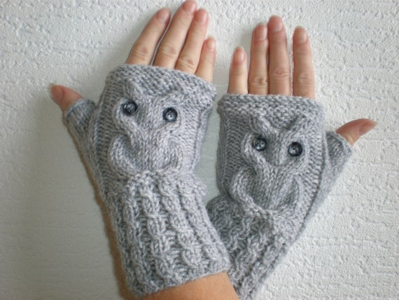Hand-knitted light grey color wrist warmers with knitted owl
