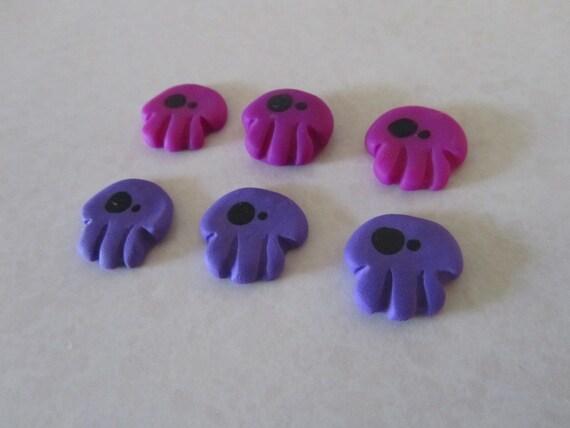 Wonky Eyed Skull flatbacks - purple mix