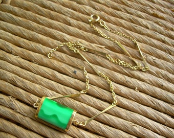 Vintage gold tone necklace with oval cylinder style pendant with green Faux malachite in plastic