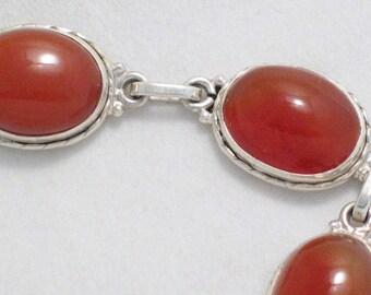 orangish brownish carnelian cabochon stone link tennis bracelet in sterling silver 7 - 8 in w/ extender