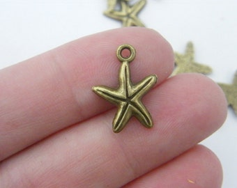 BULK 50 Starfish charms antique bronze tone BC116