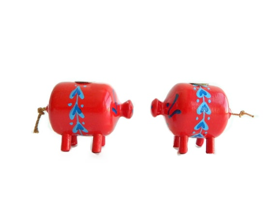 Pair of red pig candleholders from denmark