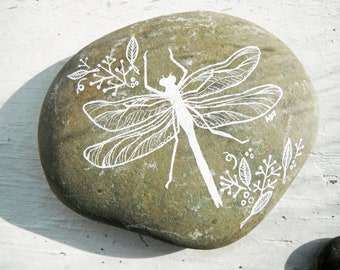 dragonfly painted river rock as a paperweight