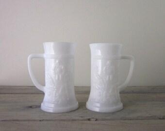 Pair of Milk Glass Steins