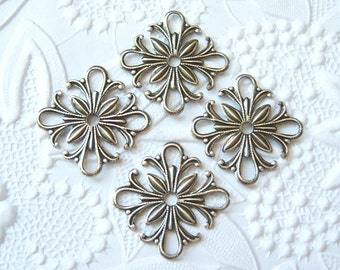 Antiqued silver plated small square filigree, lot of (4)  - AU170