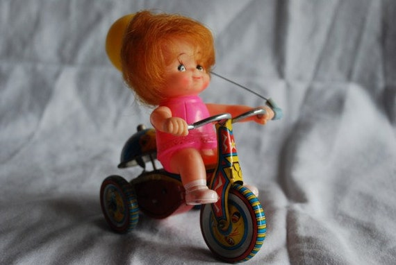 Vintage Wind Up Clockwork Tinplate Tin Plate Girl Doll On Bicycle Bike Toy