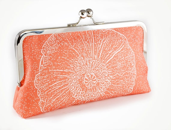 Coral clutch with poppy silhouette