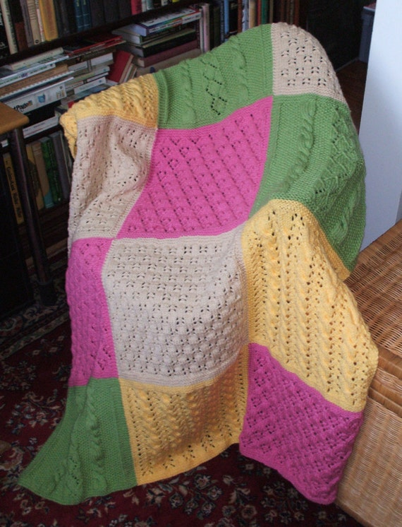 Beautiful handknit afghan in pastel colored soft acrylic for warmth and easy care.