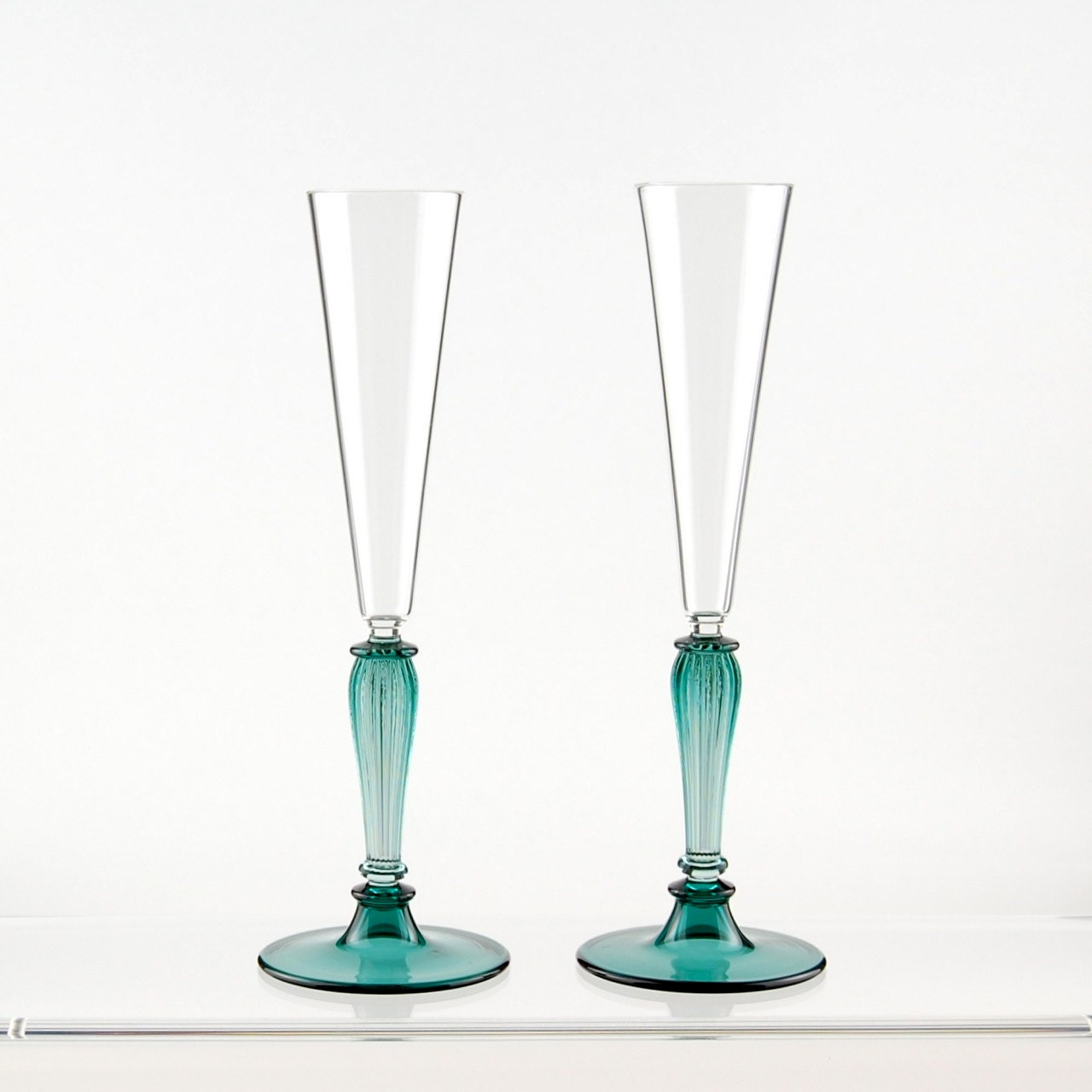 Champagne toasting flutes teal and clear hand blown by kivaford - Hand blown champagne flutes ...