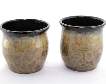 a pair of Crystalline cups: Sun-kiss crystalline glaze cups, bronze crystals with a luster background