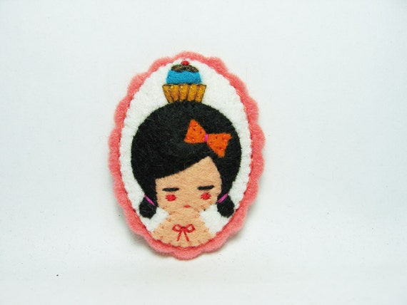 A cupcake lover with a tattoo felt pin