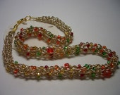 Gold necklace, orange, red, gold and green glass beads, gold lame thread, light weight, glass beads, handmade gift, Nova Scotia, Canada