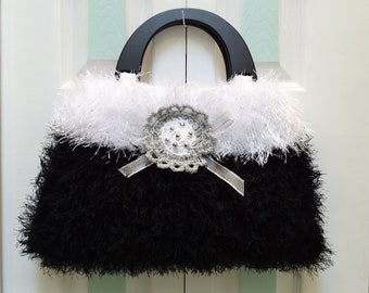 KNIT HANDBAG/PURSE : Black and White, fun fur, large,hand knitted with black wooden  handles and a silver beaded applique