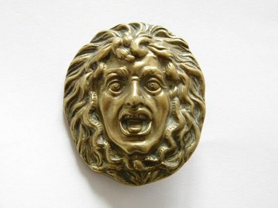 vintage brass face finding