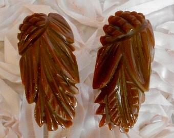 1930's Brown Carved Bakelite Dress Clips