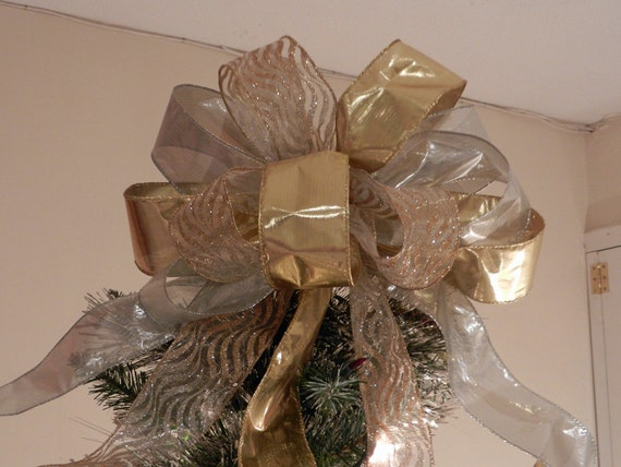 Lg  Xmas Tree topper bow made of both gold and silver lame' ribbon, a sheer ribbon with gold and silver zebra stripes
