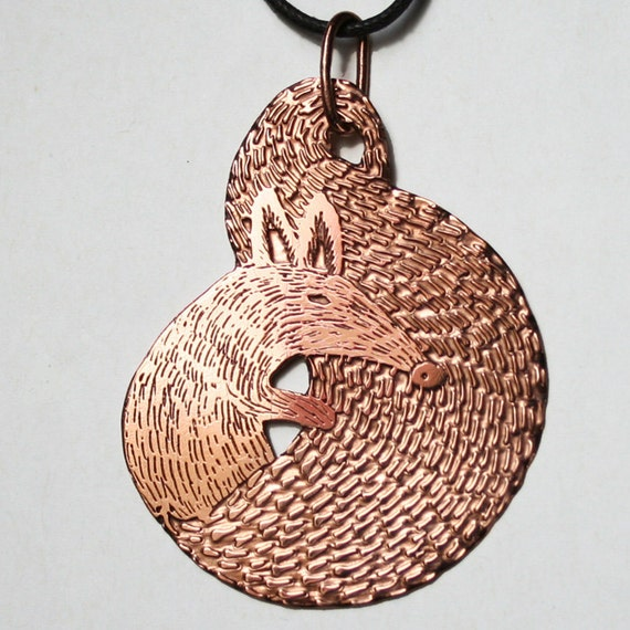 Curled up fox pendant