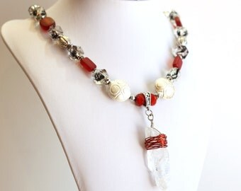 Crystal Quartz red wire wrapped pendant on red silver and black beaded necklace