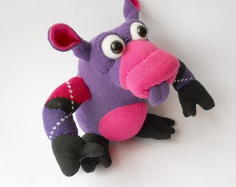 plush pink monster doll,  sock creature
