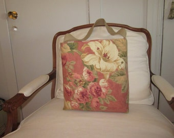 Victorian floral print with rose color background and multi color flowers.