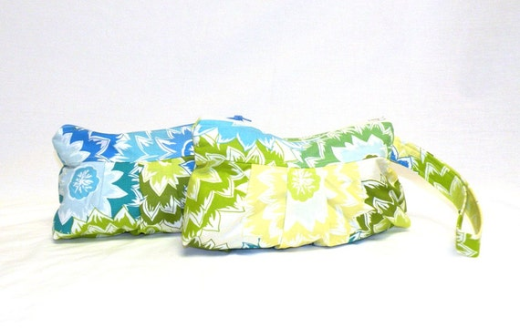 Pleated Wristlet in dahlia print in mixed shades of lemon yellow, green, lime green, light blue, bright blue, and turquoise