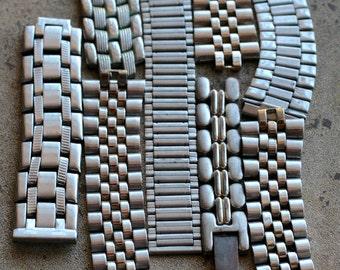 Selection of assorted watch strap bracelet parts -- D16