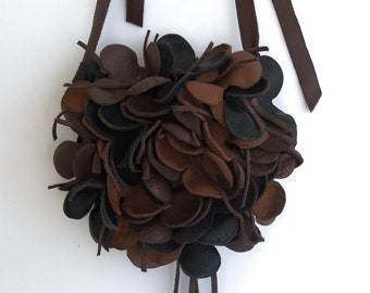 brown, black leather handbag with flower and fringe by Tuscada.  Made to order.