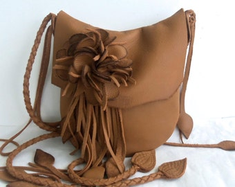 Camel tan leather handbag messenger with flower and 'leaf' fringe by Tuscada. Made to order.
