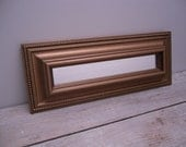 narrow contemporary gold mirror