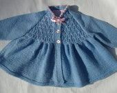 Cardigan/jumper/sweater for a baby girl, hand knitted vintage smocked style, blue with pink accents, age 0-6 months.  Made to order