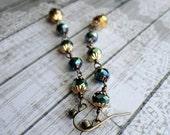 Sparkling green-black and gold aurora borealis glass dangle earrings, Starlight Star Bright