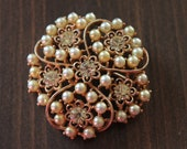 Vintage gold and pearl brooch conversation piece