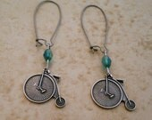Penneyfarthing old fashioned bicycle earrings with Czech glass beads and gunmetal wires Steampunk